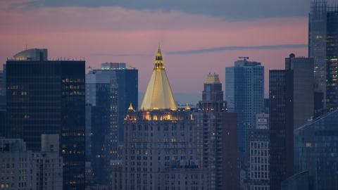 AX121_076.0000074F - Aerial stock photo of Gold roof of the New York Life Building in Midtown at sunset in New York City