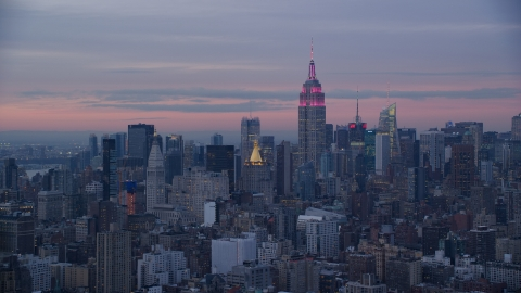 AX121_077.0000073F - Aerial stock photo of Empire State Building and Midtown skyscrapers at sunset in Midtown, New York City