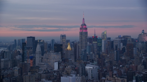 AX121_077.0000233F - Aerial stock photo of Empire State Building at Midtown high-rises at sunset in Midtown, New York City