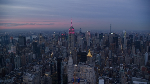 AX121_081.0000000F - Aerial stock photo of The Empire State Building and Midtown Manhattan skyscrapers at sunset in New York City