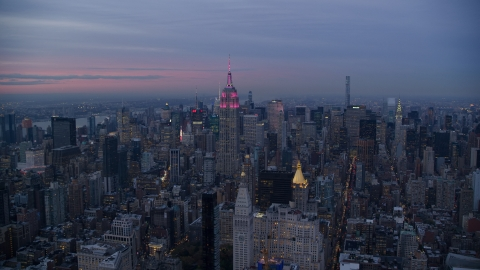 AX121_081.0000054F - Aerial stock photo of The Empire State Building and Midtown high-rises at sunset in New York City