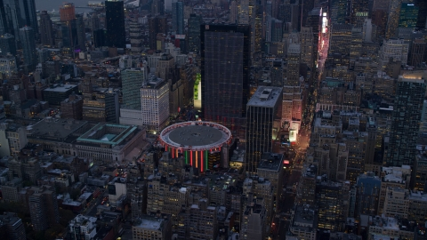 AX121_084.0000063F - Aerial stock photo of Madison Square Garden at sunset in Midtown Manhattan, New York City