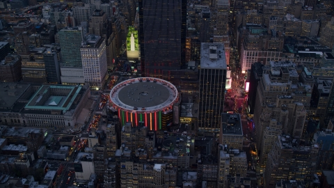 AX121_084.0000279F - Aerial stock photo of The Madison Square Garden arena at sunset in Midtown Manhattan, New York City