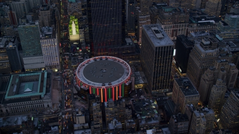 AX121_085.0000087F - Aerial stock photo of The Madison Square Garden arena at sunset in Midtown, New York City