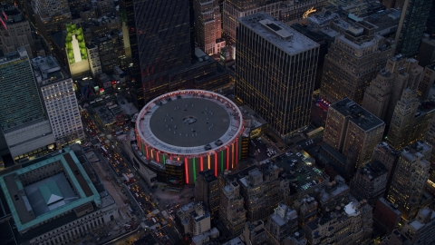 AX121_085.0000286F - Aerial stock photo of Madison Square Garden at sunset in Midtown, New York City