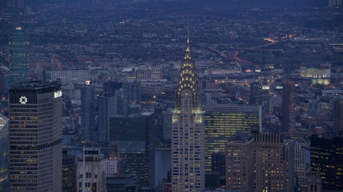 AX121_089.0000062F - Aerial stock photo of Top of Chrysler Building at sunset in Midtown, New York City