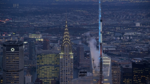 AX121_089.0000311F - Aerial stock photo of The Chrysler Building at sunset in Midtown Manhattan, New York City