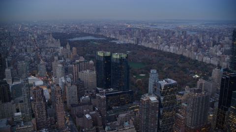 AX121_091.0000084F - Aerial stock photo of Time Warner Center and Central Park at sunset in New York City