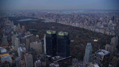 AX121_091.0000268F - Aerial stock photo of Time Warner Center towers and Central Park at sunset in New York City