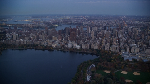 AX121_096.0000100F - Aerial stock photo of Upper East Side apartment buildings near Central Park at sunset, New York City