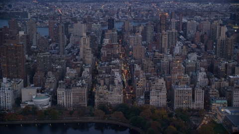 AX121_097.0000043F - Aerial stock photo of Upper East Side apartment buildings at sunset in New York City