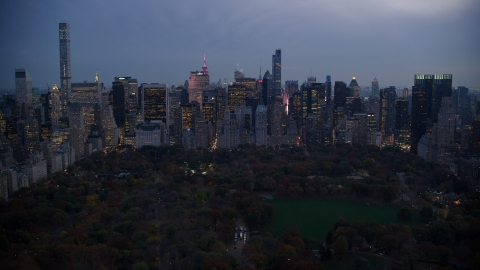 AX121_100.0000000F - Aerial stock photo of Skyscrapers in Midtown and Central Park at sunset in New York City