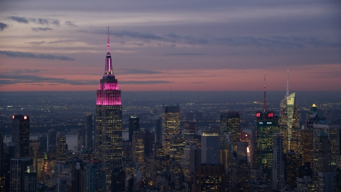 AX121_113.0000150F - Aerial stock photo of Empire State Building and Midtown skyscrapers at sunset in New York City