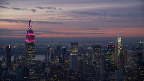 AX121_114.0000092F - Aerial stock photo of The Empire State Building and Midtown high-rises at sunset, New York City