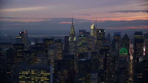 AX121_117.0000133F - Aerial stock photo of The Chrysler Building and Midtown high-rises at sunset in New York City