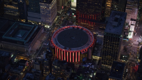 AX121_129.0000338F - Aerial stock photo of Madison Square Garden at sunset in Midtown Manhattan, New York City