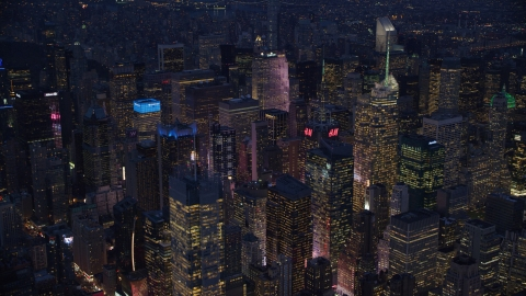 AX121_131.0000079F - Aerial stock photo of Midtown Manhattan skyscrapers at night in New York City