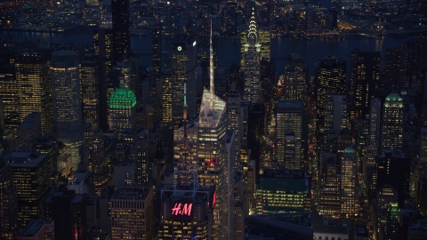 AX121_132.0000030F - Aerial stock photo of Top of Bank of America Tower in Midtown at night in New York City