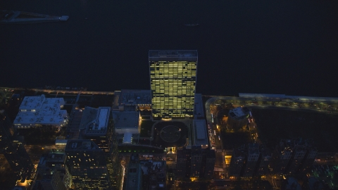 AX121_139.0000135F - Aerial stock photo of The United Nations at night in Midtown, New York City