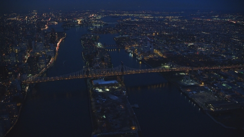 AX121_141.0000095F - Aerial stock photo of The Queensboro Bridge and Roosevelt Island at night in New York City