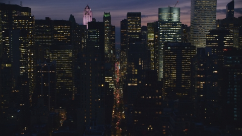 AX121_147.0000052F - Aerial stock photo of Midtown city canyon at night in New York City