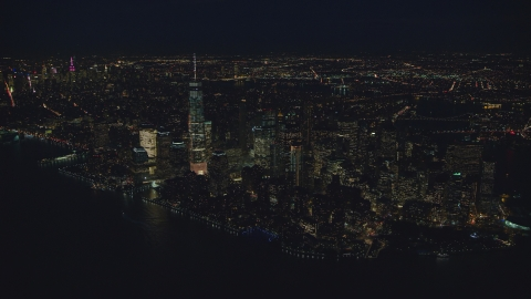 AX121_173.0000009F - Aerial stock photo of Freedom Tower and Lower Manhattan at night, New York City