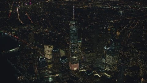 AX121_174.0000176F - Aerial stock photo of Freedom Tower and the World Trade Center Memorial at night in Lower Manhattan, New York City