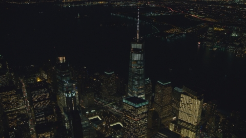 AX121_179.0000056F - Aerial stock photo of The World Trade Center Memorial and Freedom Tower at night in New York City