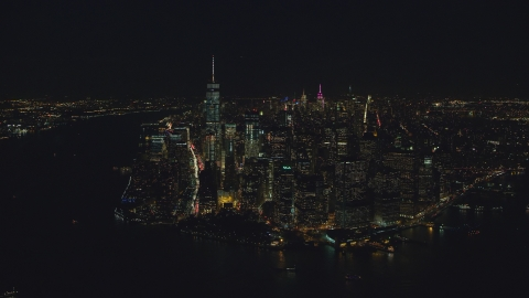 AX121_193.0000103F - Aerial stock photo of Lower Manhattan skyscrapers at night in New York City