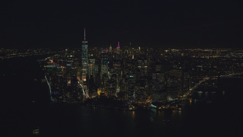 AX121_193.0000245F - Aerial stock photo of Lower Manhattan skyscrapers at night in New York City