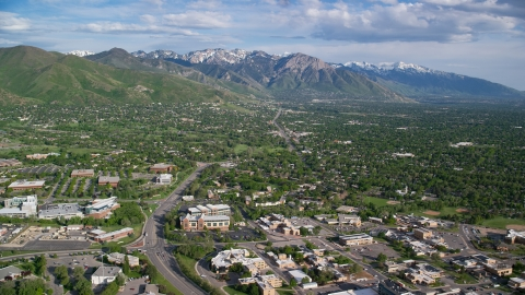AX129_079.0000000F - Aerial stock photo of Salt Lake City Suburbs, Wasatch Range, Salt Lake City, Utah