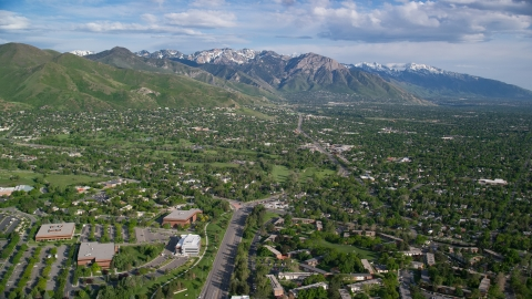 AX129_079.0000295F - Aerial stock photo of Salt Lake City Suburbs, Wasatch Range, Salt Lake City, Utah