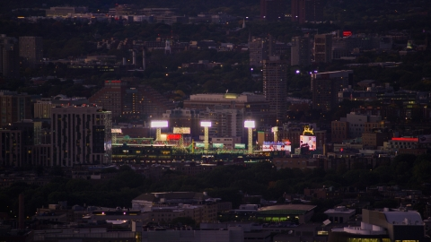 AX141_013.0000338 - Aerial stock photo of A baseball game and bright lights at Fenway Park, Boston, Massachusetts, twilight