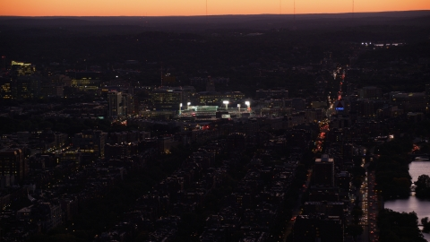 AX141_029.0000135 - Aerial stock photo of Fenway Park baseball stadium with bridge lights in Boston, Massachusetts, twilight