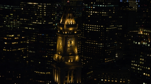 AX141_078.0000038 - Aerial stock photo of The top of Custom House Tower skyscraper in Downtown Boston, Massachusetts, night