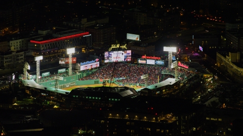 AX141_132.0000000 - Aerial stock photo of A baseball game at Fenway Park stadium in Boston, Massachusetts, night