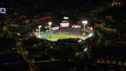 AX141_180.0000136 - Aerial stock photo of A baseball game at Fenway Park in Boston, Massachusetts, night