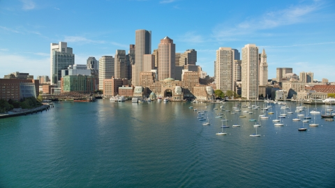 AX142_036.0000275 - Aerial stock photo of Rowes Wharf and tall skyscrapers in Downtown Boston, Massachusetts