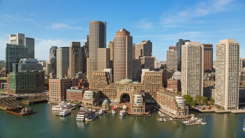 AX142_037.0000138 - Aerial stock photo of Rowes Wharf, One and Two International Place and skyscrapers in Downtown Boston, Massachusetts