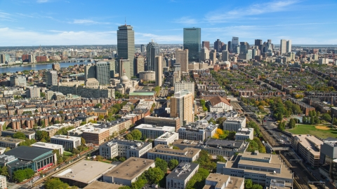 AX142_147.0000071 - Aerial stock photo of City buildings and tall skyscrapers in Downtown Boston, Massachusetts