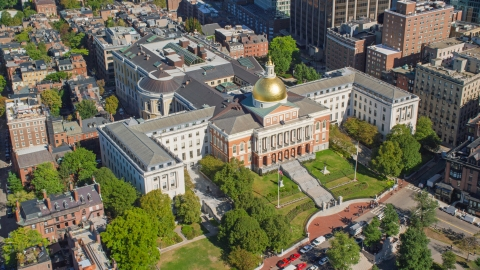 AX142_167.0000169 - Aerial stock photo of The Massachusetts State House in Downtown Boston, Massachusetts