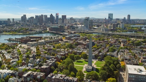 AX142_195.0000181 - Aerial stock photo of Bunker Hill Monument and the Downtown Boston skyline, Charlestown, Massachusetts