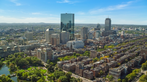 AX142_200.0000252 - Aerial stock photo of Towering skyscrapers and city buildings in Downtown Boston, Massachusetts