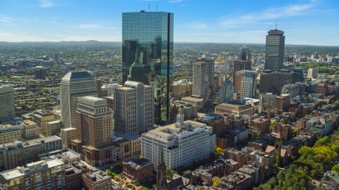 AX142_201.0000209 - Aerial stock photo of Towering skyscrapers and city buildings in Downtown Boston, Massachusetts