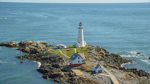 AX142_262.0000143 - Aerial stock photo of Boston Light by Boston Harbor, Little Brewster Island, Massachusetts