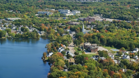 AX143_008.0000000 - Aerial stock photo of Small town with waterfront homes in autumn, Braintree, Massachusetts