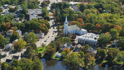 AX143_009.0000128 - Aerial stock photo of South Congregational Church in a small town, autumn, Braintree, Massachusetts