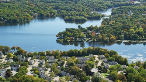 AX143_015.0000125 - Aerial stock photo of A small town on the shore of Whitmans Pond in autumn, Weymouth, Massachusetts