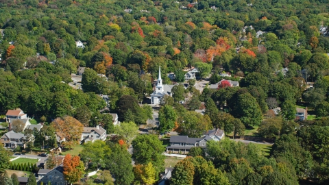 AX143_018.0000210 - Aerial stock photo of A small town church in autumn, Hingham, Massachusetts