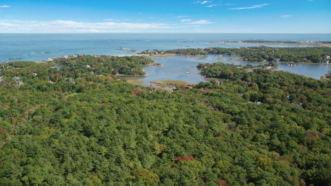 AX143_024.0000262 - Aerial stock photo of Forest and a small coastal community in autumn, Cohasset, Massachusetts